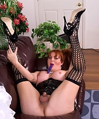 Naughty TS in sexy black stockings playing with a toy