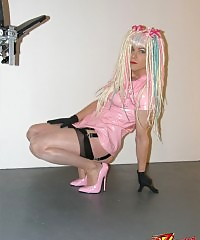 Naughty crossdresser with crazy hair wearing pink pvc