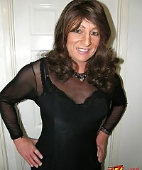 Gorgeous crossdresser wearing black nylons and matching dress